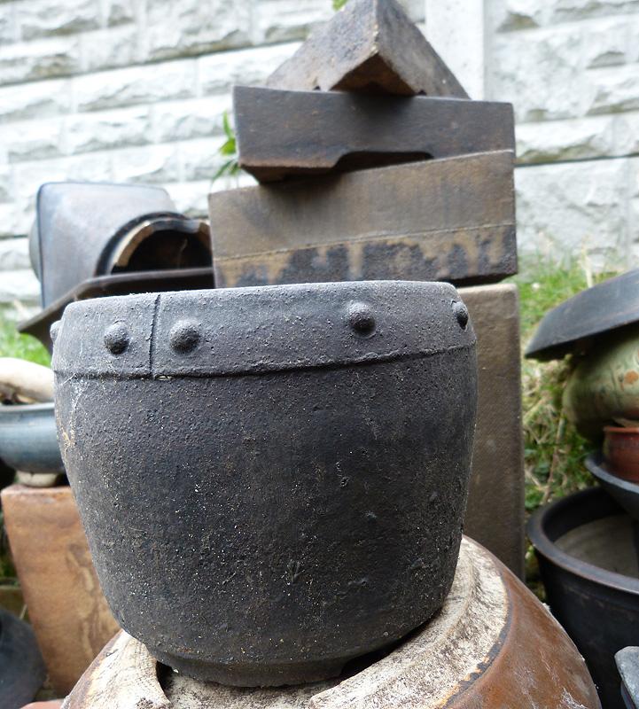 Many unique bonsai pot styles.